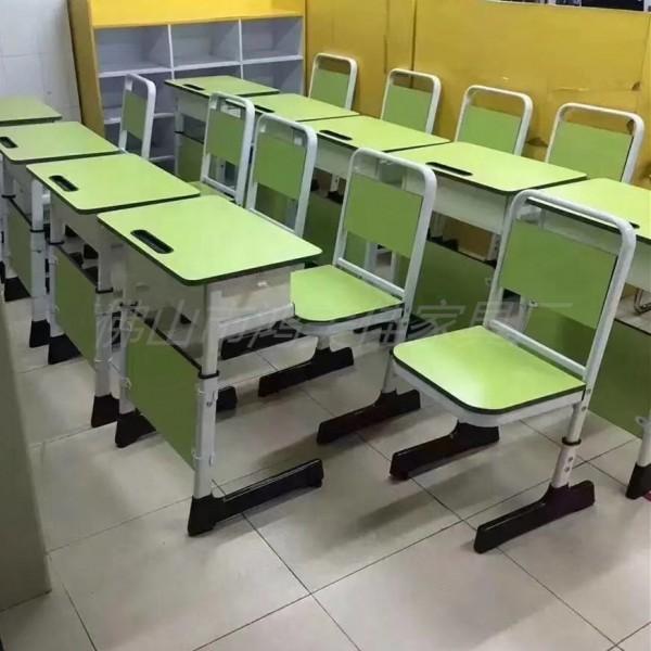 厂家定制防火板靠背钢木儿童学生单人位课桌椅可升降